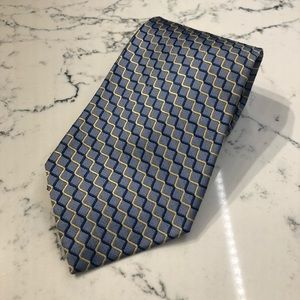 Blue and yellow patterned tie. By Tom James.
